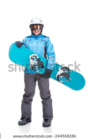 Young smiling woman is posing with snowboard and goggles in studio, isolated on white background. - stock photo