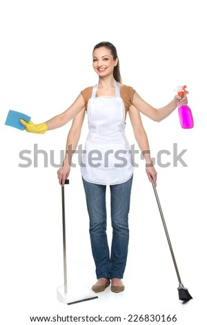 Young smiling woman isolated over white background. beautiful brunette with four hands and cleaning tools - stock photo