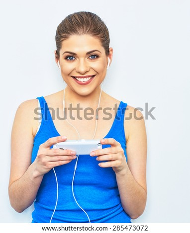 Young smiling woman listening music with smartphone. Happy girl. Isolated portrait. - stock photo