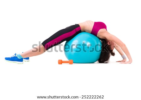 Young smiling woman makes exercise with fitball and dumbbells, full length portrait isolated over white background