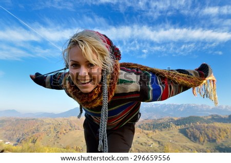 young smiling woman outdoor in autumn - stock photo