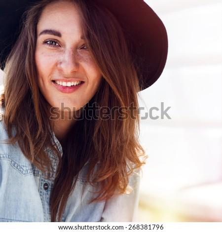 Young smiling woman outdoors portrait. Closeup portrait. - stock photo