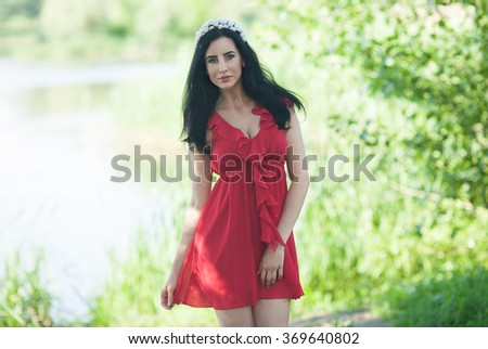 Young smiling woman outdoors portrait. Soft sunny colors.Close portrait. beautiful smiling girl. Woman in the city in summertime. Summer outdoor portrait - stock photo