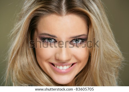 Young smiling woman portrait on white background, isolated