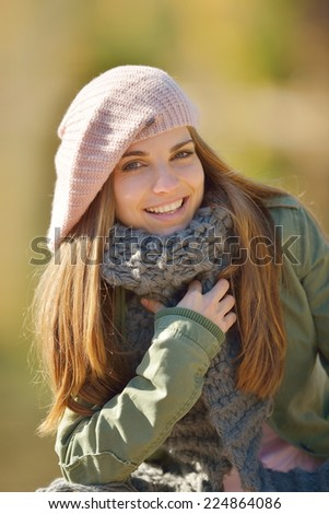 young smiling woman portrait outdoor in autumn - stock photo