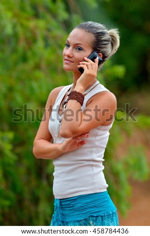 young smiling woman talking on the cellphone outdoor