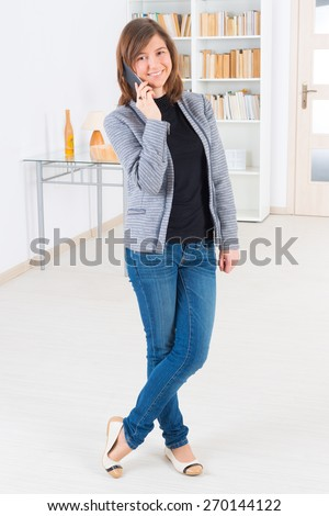 Young, smiling woman talking on the phone - stock photo