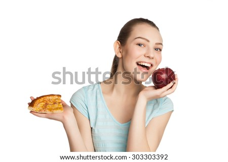 Young smiling woman with a piece of pizza and apple, isolated on white - stock photo