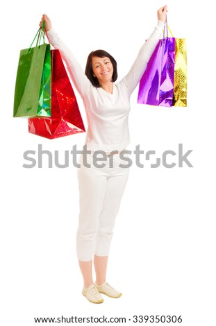 Young smiling woman with bags isolated - stock photo