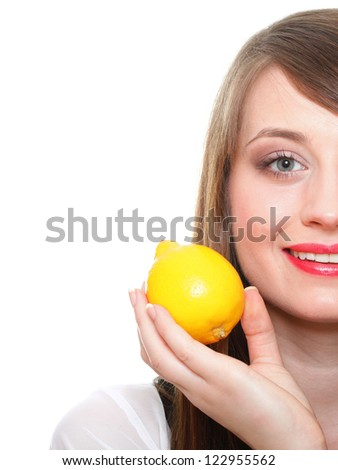 Young smiling woman with fruits, lemon. Over white background - stock photo