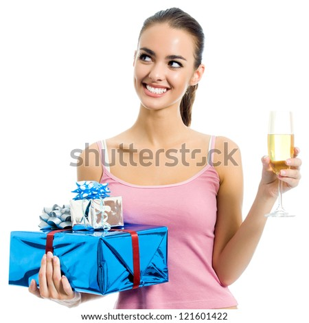 Young smiling woman with gift and champagne, isolated over white background - stock photo