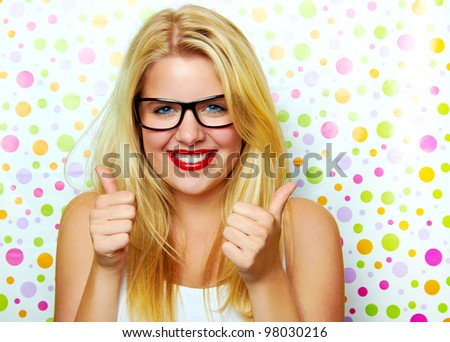 young smiling woman with thumbs up - stock photo