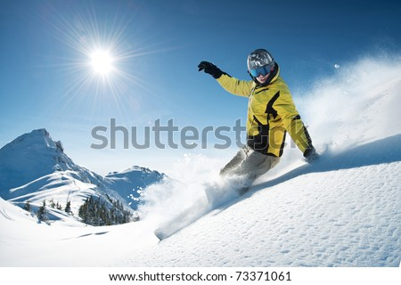Young snowboarder in deep powder - extreme freeride - stock photo