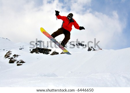 Young Snowboarder Jumping extreme high over the snow