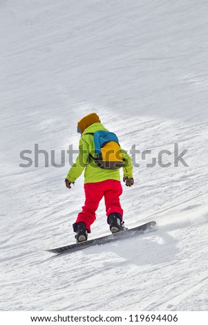 Young snowboarder on the snow