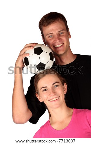 Young soccer fans having some fun with a soccer ball - stock photo