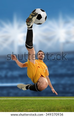 Young soccer player performing a bicycle kick inside stadium