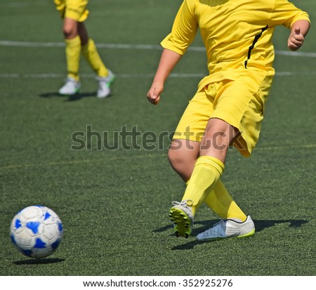 Young soccer player with a ball - stock photo