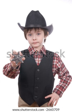 Young soft focused sheriff boy holding a sharp marshals badge and a cowboy hat isolated on white - stock photo
