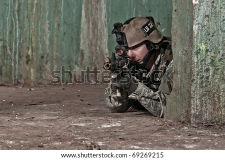Young soldier on patrol - stock photo