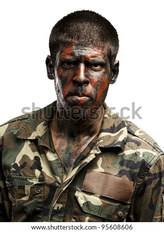 young soldier with camouflage paint looking very serious over white - stock photo