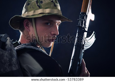 Young soldier with Kalashnikov assault rifle.