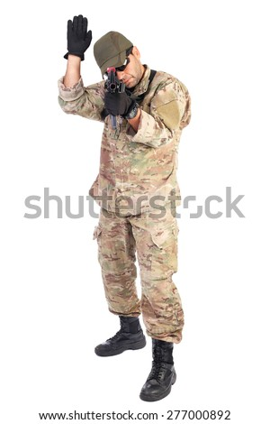 Young soldier with one ram raised ready to fight over white background - stock photo