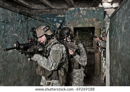 Young soldiers on patrol - stock photo