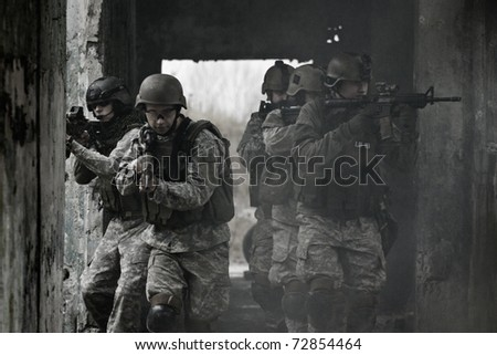 young soldiers with guns