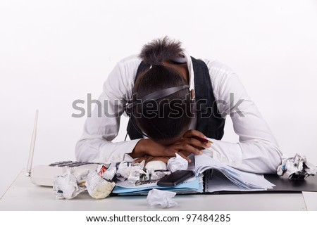 Young South African woman overwhelmed by work, telephones and stress. Tired!