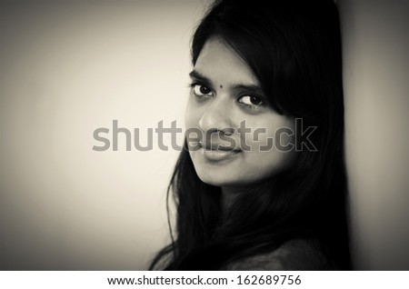 Young south asian teenage girl with nice expression. - stock photo