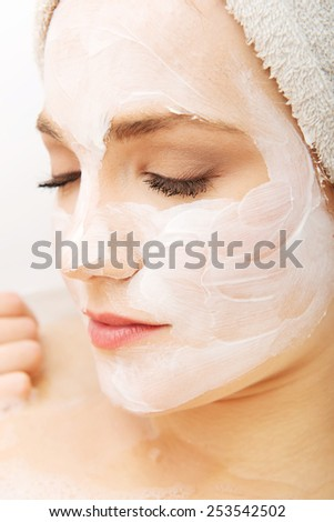 Young spa woman relaxing with cream moisturizer.  - stock photo