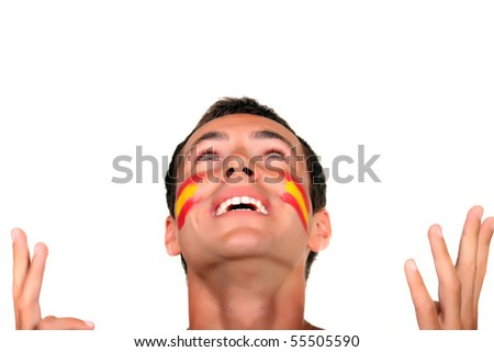 Young spanish football fan prays for win - stock photo