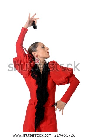young Spanish woman dancing Sevillanas with castanets in hands wearing typical folk red dress in flamenco traditional dance of Spain concept isolated on white background