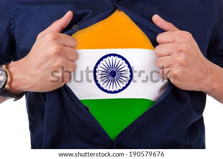 Young sport fan opening his shirt and showing the flag his country India - stock photo