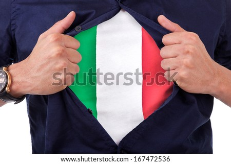 Young sport fan opening his shirt and showing the flag his country Italy, Italian flag - stock photo