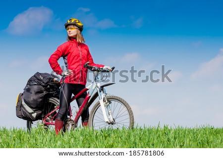 young sportive female biker  - stock photo