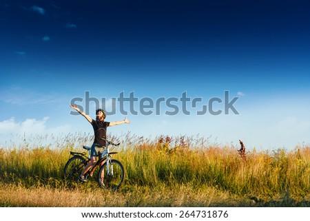 young sportive female biker enjoy sunny days - stock photo