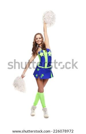 Young sports flexible cheerleader girl in the green-blue suit. Young high school female dancer standing with pom-poms on isolated white background.