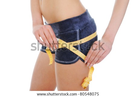 Young sports woman measuring waist. Isolated on white background - stock photo
