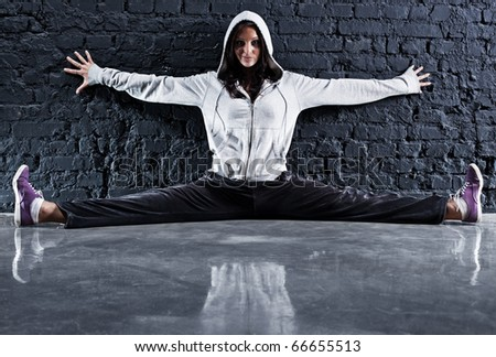 Young sports woman. On wall background. - stock photo