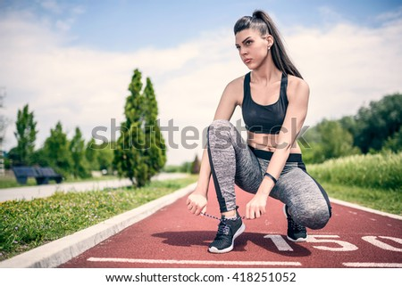 Young Sports Woman Preparing To Run