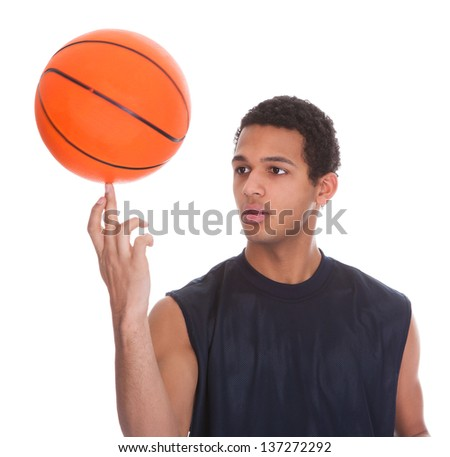 Young Sportsman Balances Ball On A Finger Over White Background - stock photo
