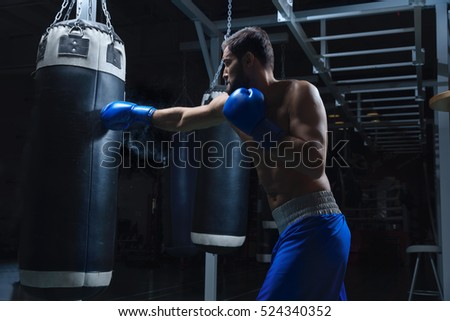 Young sportsman with a punching bag