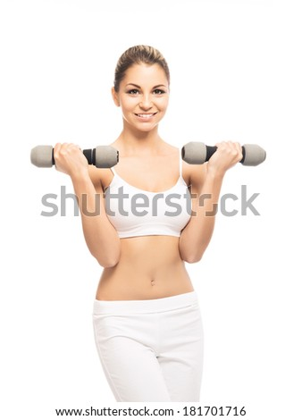 Young, sporty, fit and beautiful girl with the dumbbells isolated on white