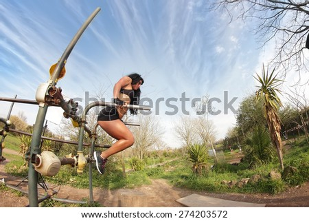 young sporty fitness woman at the parallel bars - stock photo
