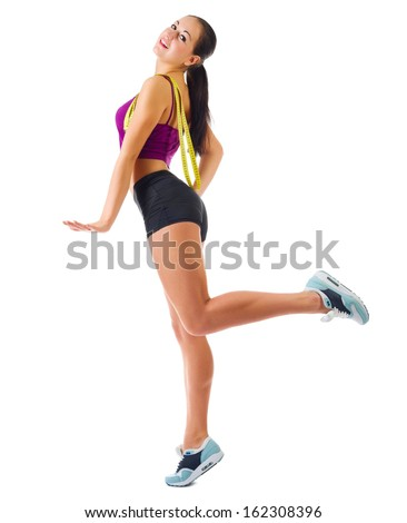 Young sporty girl with centimeter tape isolated - stock photo