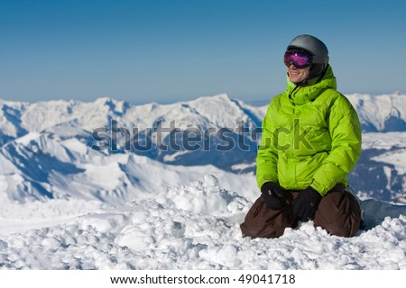 Young sporty man in snow mountains. French Alps - stock photo