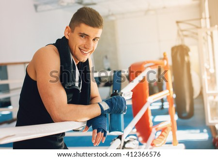 Young sporty man in the gym. Male boxer. Training. Mood, break, rest, motivation, coach - sport concept. - stock photo