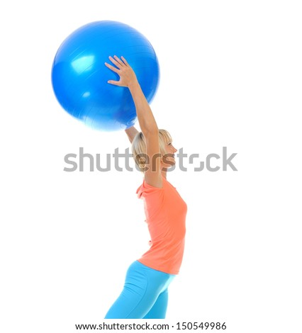 Young sporty woman does weight training with a blue ball in the gym. isolated on a white background